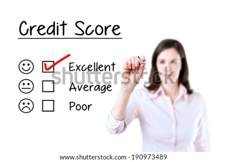 Hand putting check mark with red marker on excellent credit score evaluation form.  - stock photo