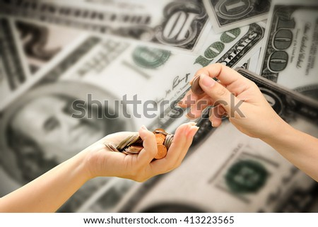 hand putting coin from pile of coins in hand with blur dollar banknotes background - stock photo