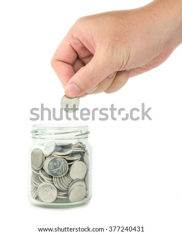 hand putting coin in to money jar