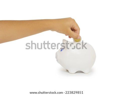 hand putting coin into a piggy bank isolated on white - stock photo