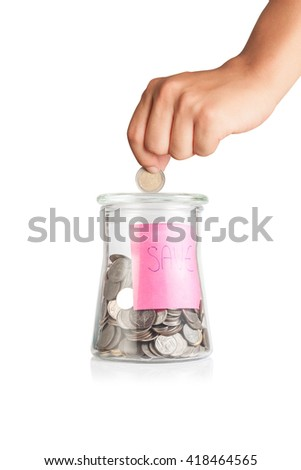 Hand putting coin into piggy bank on white background,Saving money concept