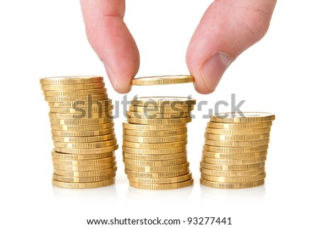 Hand putting golden coins  on white background
