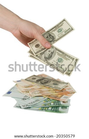 Hand putting one-hundred dollar bills on a pile of one-hundred euro bills (isolated on white)