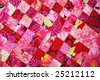 Hand quilted red quilt seen from above - stock photo