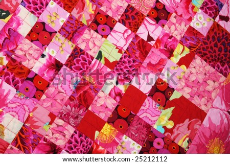 Hand quilted red quilt seen from above