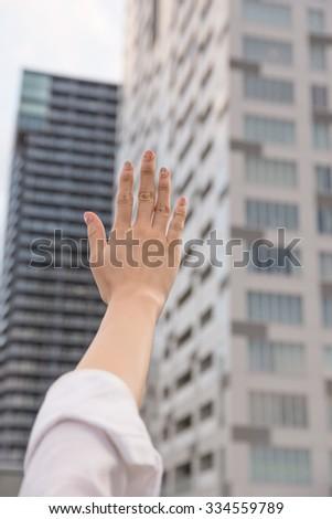 Hand Raised asian woman - stock photo