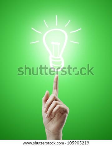 hand raised upwards indicates drawing  lamp - stock photo