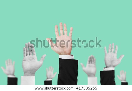 Hand raising upward with unique colored one, on pastel vintage tone background , abstract concept and ideas - stock photo