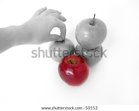 Hand reaching for an apple, desaturated.