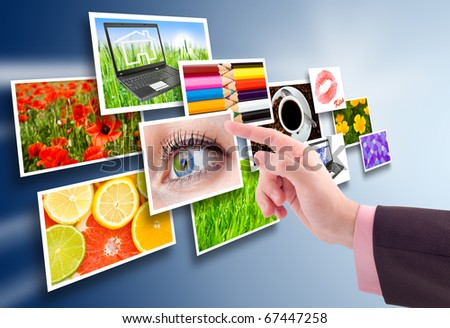 Hand reaching images streaming from the deep. - stock photo