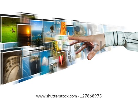Hand reaching images streaming from the deep on white background - stock photo