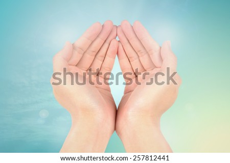 hand reaching on filters sky nature background - stock photo