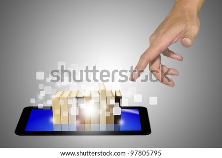 Hand reaching Stack of Book over Touch Screen Tablet PC in E-book concept - stock photo