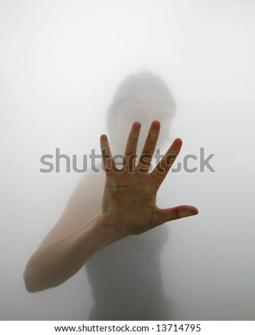 Hand reaching through fog - stock photo