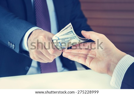 Hand receiving money from businessman - vintage tone - stock photo