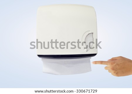 Hand recommend to take tissue paper from tissue dispenser - stock photo