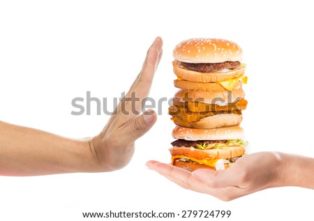 Hand refusing junk food with white background - stock photo