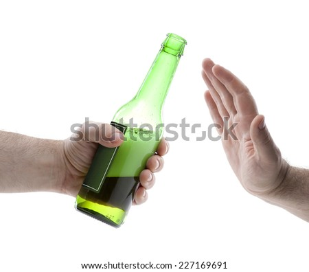 Hand reject a bottle of beer isolated on white background - stock photo
