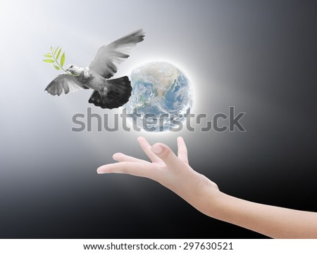 Hand releasing a bird into the air , concept for freedom, peace and spirituality,Elements of image are furnished by NASA - stock photo