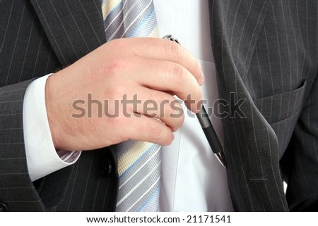 Hand removing a pen from his inside pocket - stock photo
