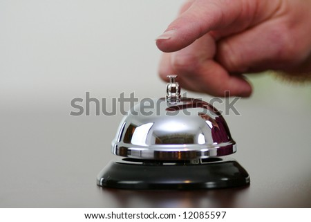 Hand ringing a bell for customer service