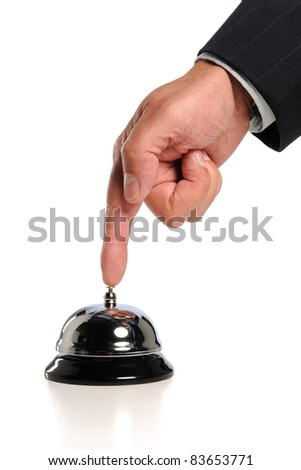 Hand ringing bell isolated over white background
