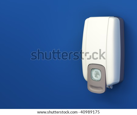 Hand sanitizer dispenser on blue wall with layout copy space and clipping path.