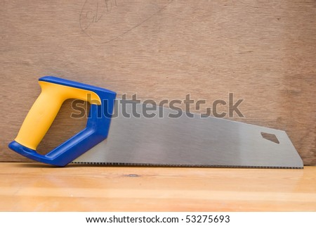 Hand saw against wood.