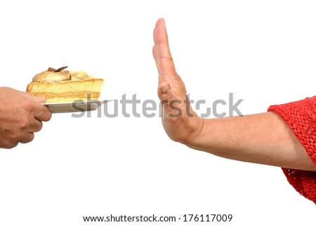 Hand says stop to a piece of cake - stock photo
