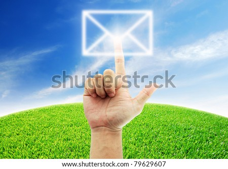 Hand select mail green grass blue sky lifestyle for design - stock photo