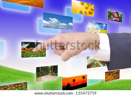 hand selecting images streaming from the deep - stock photo