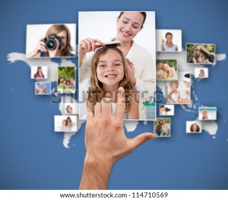 Hand selecting picture from interface - stock photo