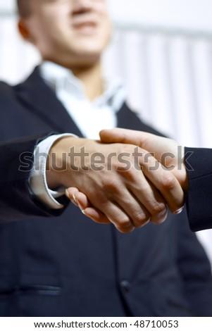 Hand-shake - stock photo