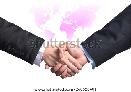 Hand shake between a businessman and a businesswoman on world map background - stock photo