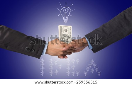 Hand shake between a businessman with dollar money for idea of success - stock photo