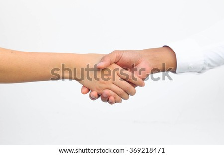 Hand shake between a man and a woman isolated on white - stock photo