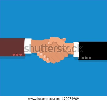 Hand shake between two colleagues - stock photo
