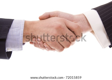 Hand shake between two persons isolated on white - stock photo