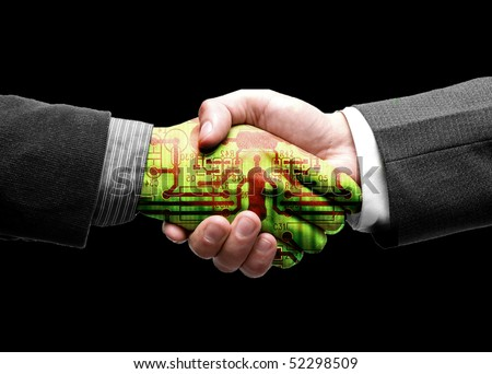 hand shake with technology - stock photo