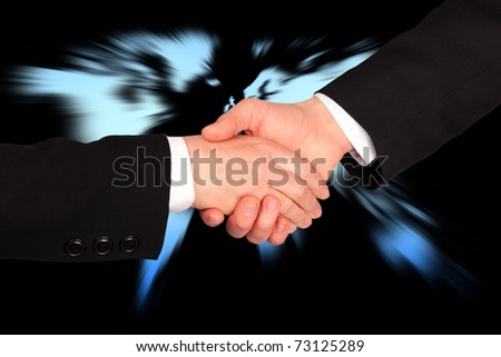 Hand shaking in business with world map in background - stock photo