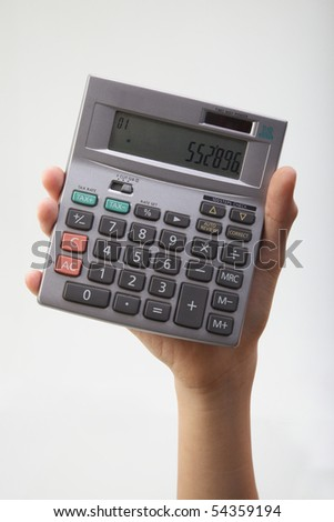hand show a calculator on the plain backgground