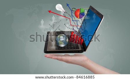 Hand show Laptop and financial Graphs