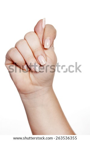 Hand showing a fig over isolated background