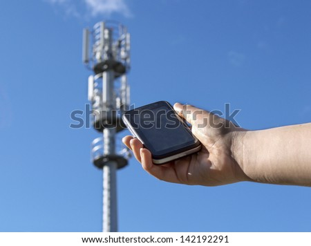hand showing a phone with an issuer - stock photo
