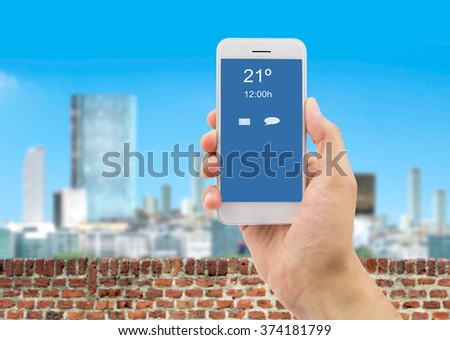 hand showing a telephone connected to wifi on the balcony of a building - stock photo