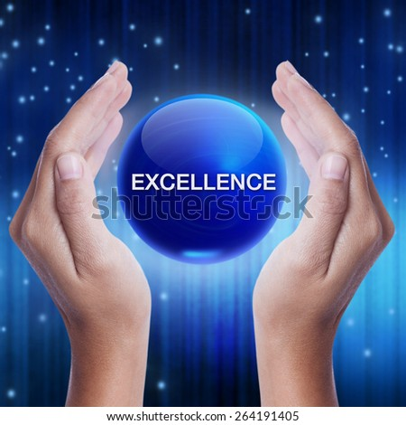 Hand showing blue crystal ball with excellence word. business concept - stock photo