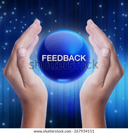 Hand showing blue crystal ball with feedback word. business concept - stock photo