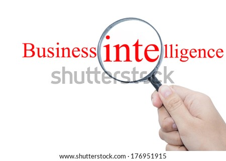 Hand Showing Business intelligence Word Through Magnifying Glass   - stock photo