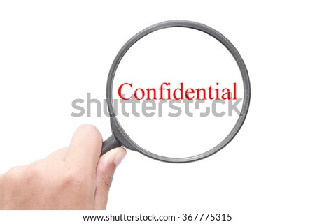 Hand showing Confidential word through magnifying glass. Magnifying glass search concept. Isolated on white background. - stock photo