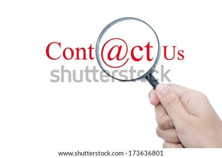 Hand Showing Contact Us Word Through Magnifying Glass  - stock photo